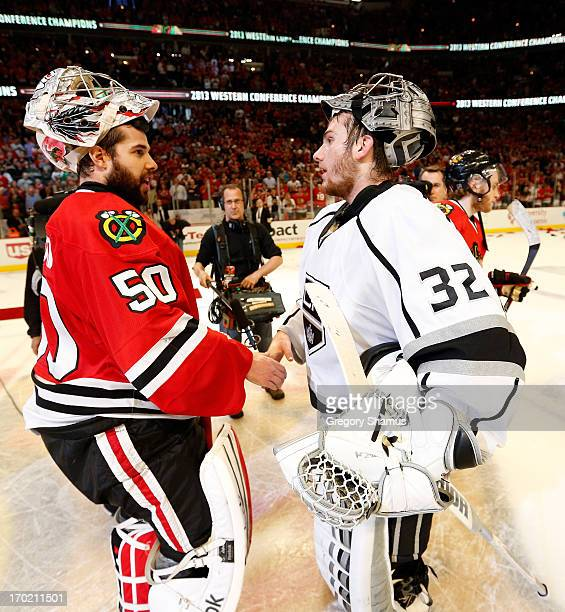 Goalie Corey Crawford of the Chicago Blackhawks is congratulated by goalie Jonathan Quick of the Los Angeles Kings after the Blackhawks won 43 in the...