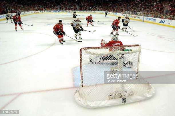 Goalie Corey Crawford of the Chicago Blackhawks lets in the gamewinning goal in the first overtime off of the stick of Daniel Paille of the Boston...