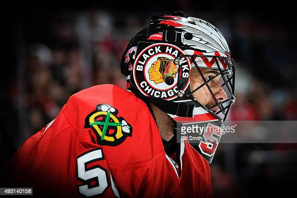 Goalie Corey Crawford of the Chicago Blackhawks looks across the ice in the first period of the NHL game against the Columbus Blue Jackets at the...