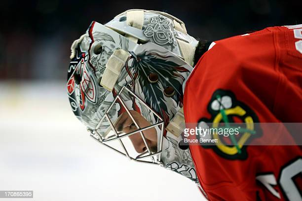 Goalie Corey Crawford of the Chicago Blackhawks looks on against the Boston Bruins in Game Two of the 2013 NHL Stanley Cup Final at United Center on...