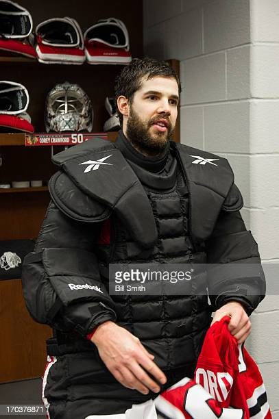 Goalie Corey Crawford of the Chicago Blackhawks stands in the locker room after the Blackhawks defeated the Los Angeles Kings in Game Five of the...