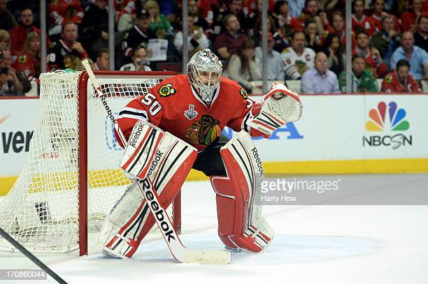 Goalie Corey Crawford of the Chicago Blackhawks tends goal against the Boston Bruins in Game Two of the NHL 2013 Stanley Cup Final at United Center...