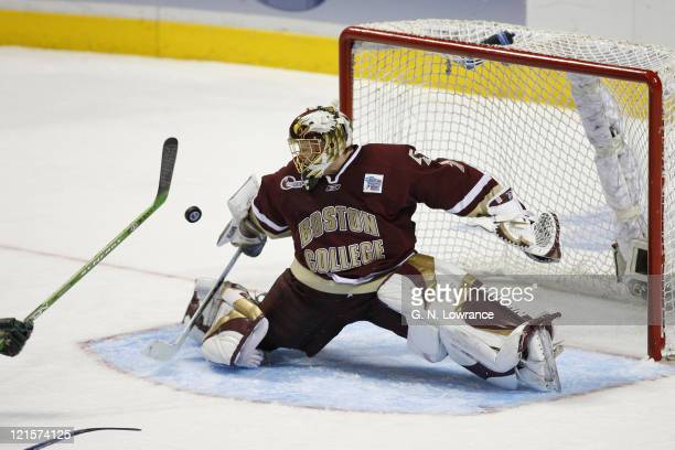 Goalie Cory Schneider of Boston College blocks a shot during 3rdperiod action in the semifinals of the NCAA frozen four at the Bradley Center in...
