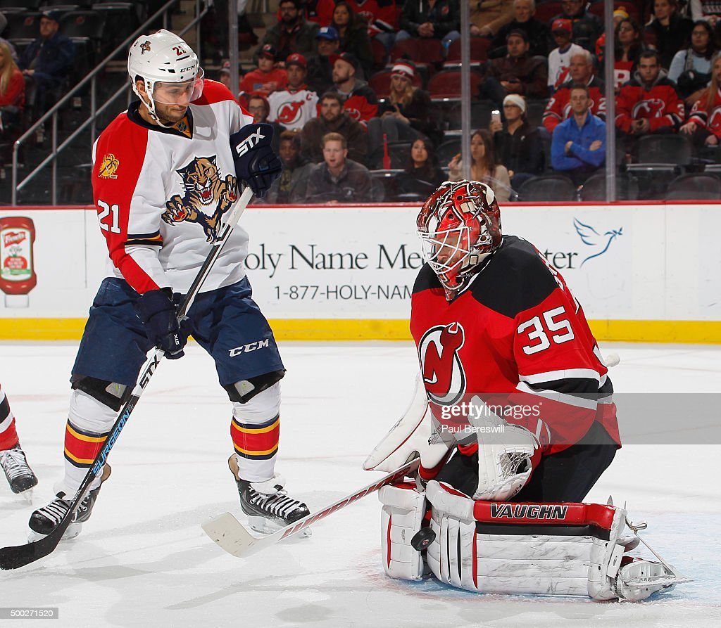 Goalie Cory Schneider #35 of the New Jersey Devils stops a shot by Vincent Trocheck #21 of the Florida Panthers during the third period of an NHL hockey game at Prudential Center on December 6, 2015 in Newark, New Jersey. Devils won 4-2.