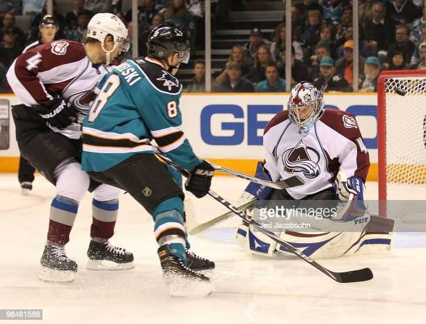 Goalie Craig Anderson of the Colorado Avalanche makes a save against Joe Pavelski of the San Jose Sharks in Game One of the Western Conference...