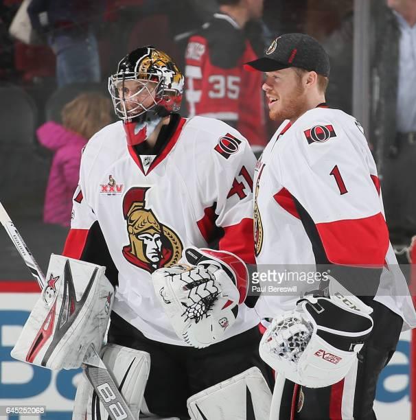 Goalie Craig Anderson of the Ottawa Senators and teammate Mike Condon skate off the ice celebrating the Senators 21 win over the New Jersey Devils...