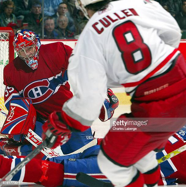 Goalie Cristobal Huet of the Montreal Canadiens makes a save against Matt Cullen of the Carolina Hurricanes in game six of the Eastern Conference...