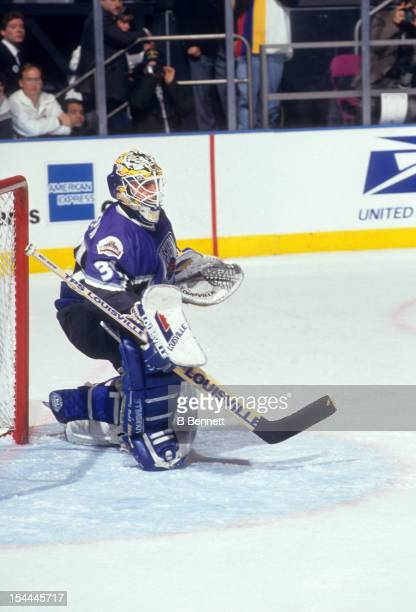 Goalie Curtis Joseph of the Western Conference and of the St Louis Blues defends the net during the 1994 45th NHL AllStar Game against the Eastern...
