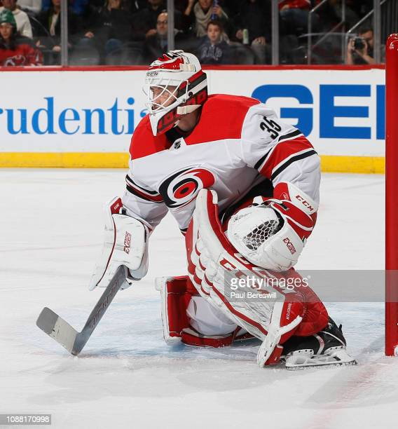 Goalie Curtis McElhinney of the Carolina Hurricanes defends his goal during an NHL hockey game against the New Jersey Devils on December 29 2018 at...