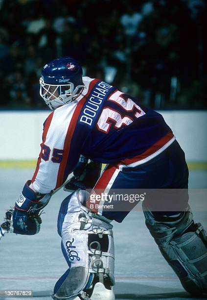 Goalie Dan Bouchard of the Winnipeg Jets passes the puck during an NHL game against the New York Islanders on December 3 1985 at the Nassau Coliseum...