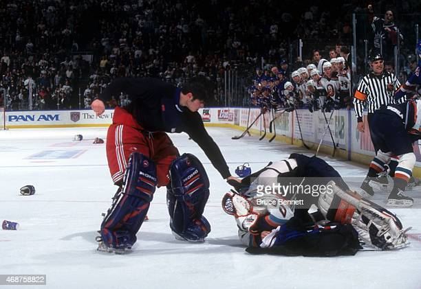Goalie Dan Cloutier of the New York Rangers fights with goalie Tommy Salo of the New York Islanders on April 4 1998 at the Nassau Coliseum in...