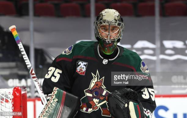 Goalie Darcy Kuemper of the Arizona Coyotes has the handle of his stick wrapped in rainbow tape in conjunction with Pride Night prior to the NHL...