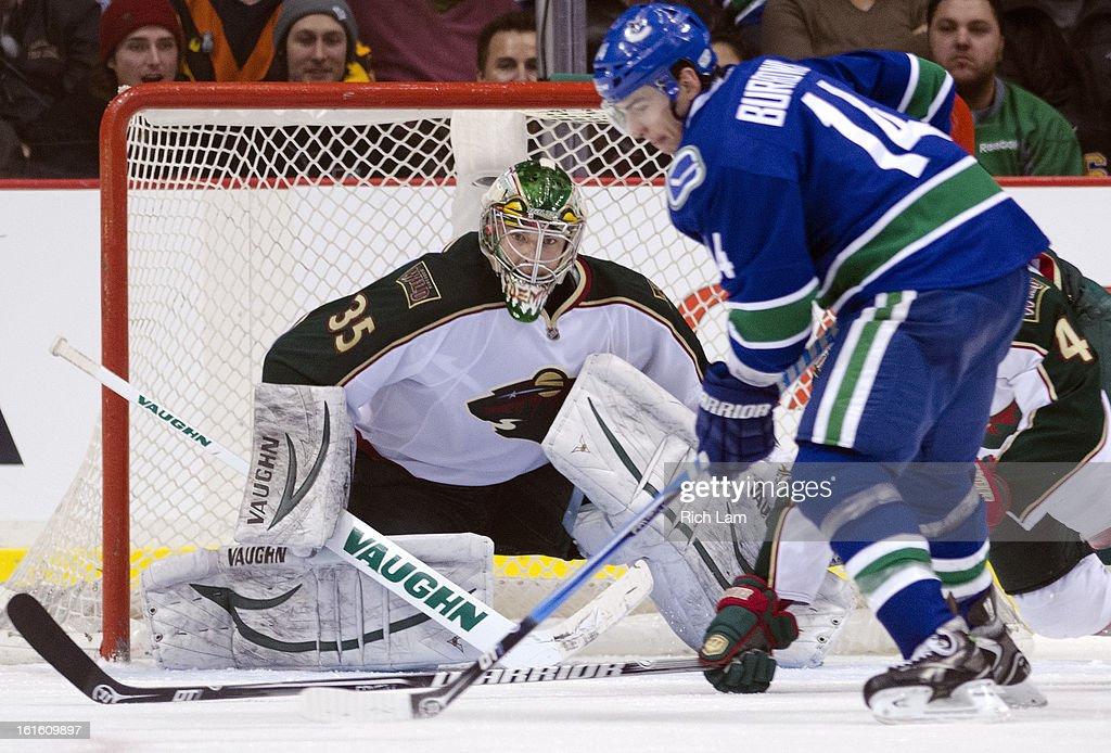 Goalie Darcy Kuemper #35 of the Minnesota Wild gets into position to make a save against Alexandre Burrows #14 of the Vancouver Canucks during the third period in NHL action on February 12, 2013 at Rogers Arena in Vancouver, British Columbia, Canada. Kuemper was playing in his first career NHL game.
