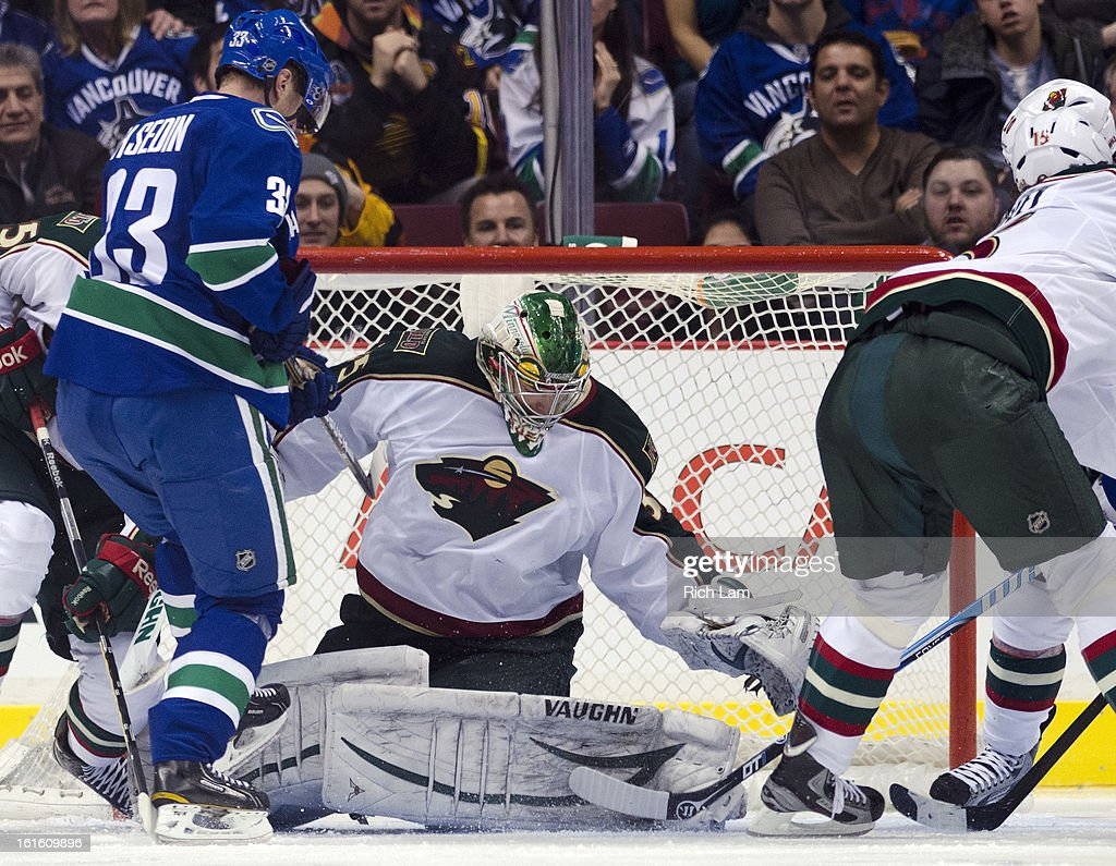 Goalie Darcy Kuemper #35 of the Minnesota Wild stops Henrik Sedin #33 of the Vancouver Canucks in close during the third period in NHL action on February 12, 2013 at Rogers Arena in Vancouver, British Columbia, Canada. Kuemper was playing in his first career NHL game.