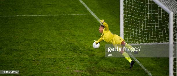 goalie defending goal - soccer goal stock pictures, royalty-free photos & images