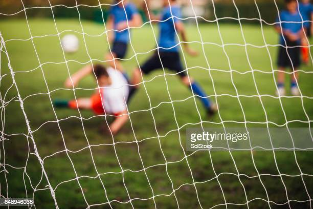 Goalie defending his Soccer Net