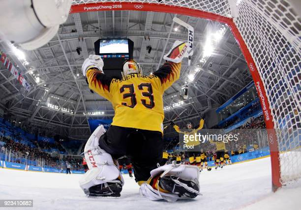 Goalie Den Birken Danny Aus of Germany celebrate with his teammates after the semifinal round of the men's hockey game against Canada at the 2018...