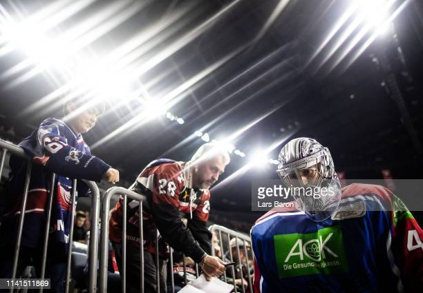 Goalie Dennis Endras of Mannheim is seen during the fourth game of the DEL PlayOffs Semi Final between Koelner Haie and Adler Mannheim at Lanxess...