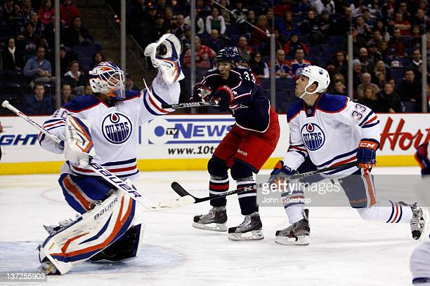 Goalie Devan Dubnyk of the Edmonton Oilers makes the save in net in front of Tomas Kubalik of the Columbus Blue Jackets during their game at...