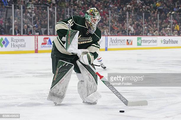 Goalie Devan Dubnyk of the Minnesota Wild controls the puck outside of the net against the Montreal Canadiens during the first period of the game on...