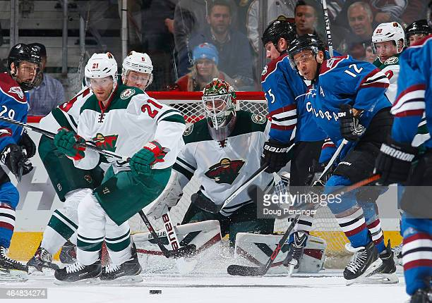 Goalie Devan Dubnyk of the Minnesota Wild defends the goal against the Colorado Avalanche at Pepsi Center on February 28 2015 in Denver Colorado The...