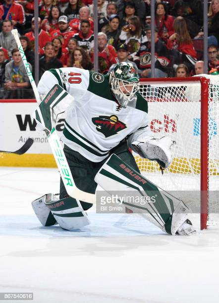 Goalie Devan Dubnyk of the Minnesota Wild guards the net against the Chicago Blackhawks in the first period at the United Center on October 12 2017...