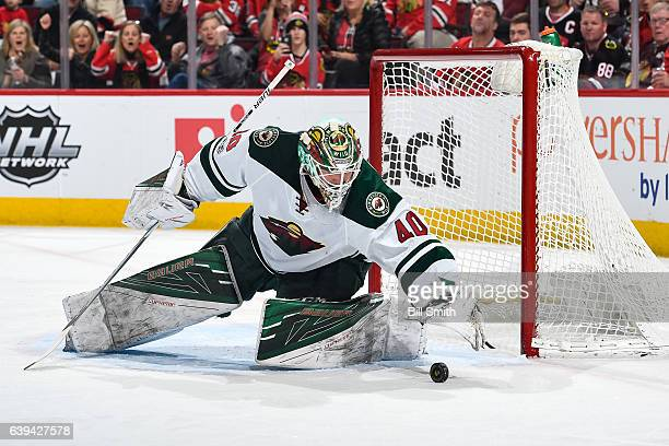 Goalie Devan Dubnyk of the Minnesota Wild stops the puck in the first period against the Chicago Blackhawks at the United Center on January 15 2017...