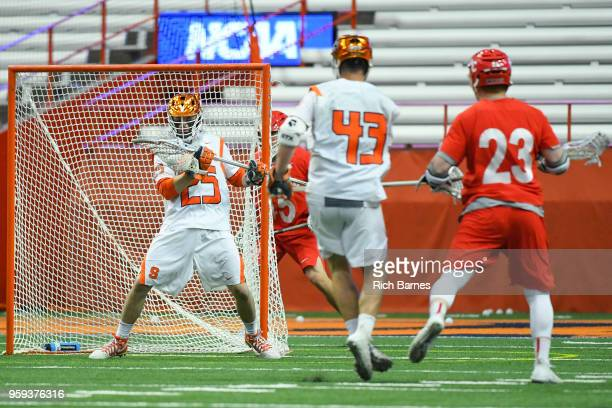 Goalie Dom Madonna of the Syracuse Orange makes a save on a shot by Jordan Dowiak of the Cornell Big Red during a 2018 NCAA Division I Men's Lacrosse...