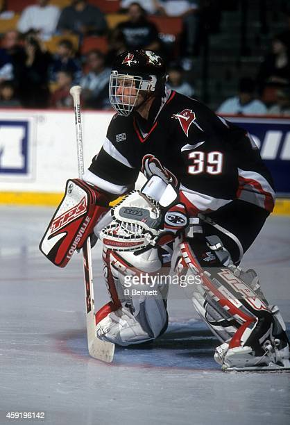 Goalie Dominik Hasek of the Buffalo Sabres defends the net during an NHL preseason game in September, 1999.