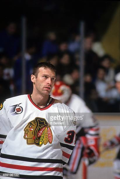 Goalie Dominik Hasek of the Chicago Blackhawks skates on the ice before an NHL game circa 1992 at the Chicago Stadium in Chicago, Illinois.