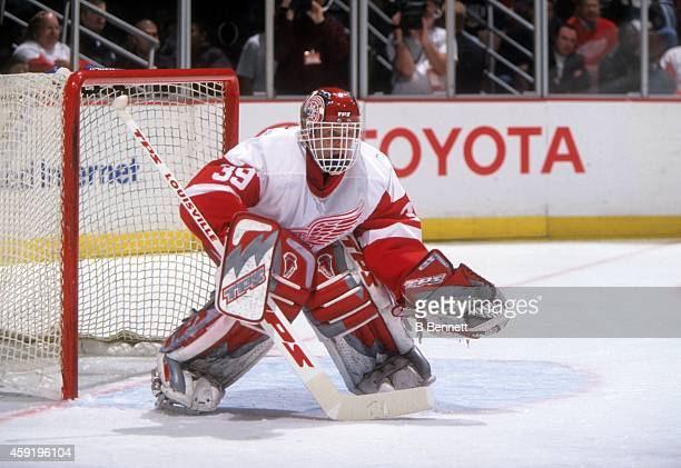 Goalie Dominik Hasek of the Detroit Red Wings defends the net during an NHL game in April, 2002 at the Joe Louis Arena in Detroit, Michigan.