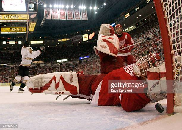 Goalie Dominik Hasek of the Detroit Red Wings lets in the gamewinning goal in overtime against Teemu Selanne of the Anaheim Ducks in game five of the...