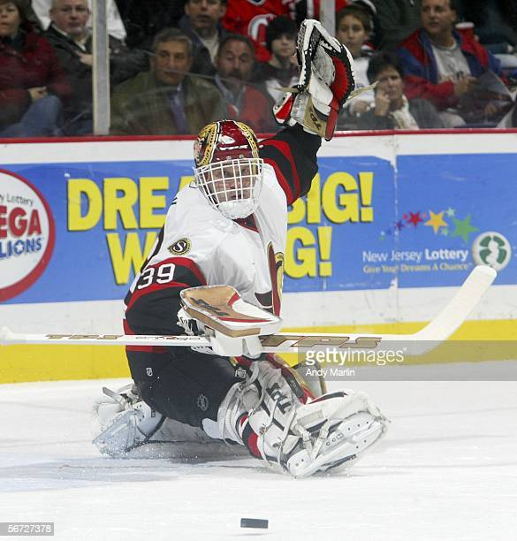 Goalie Dominik Hasek of the Ottawa Senators watches the puck after making a skate save against the New Jersey Devils at the Continental Airlines...