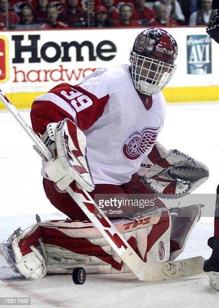 Goalie Dominik Hasik of the Detroit Red Wings deflects a shot on net with his pads during the second period of game three against the Calgary Flames...
