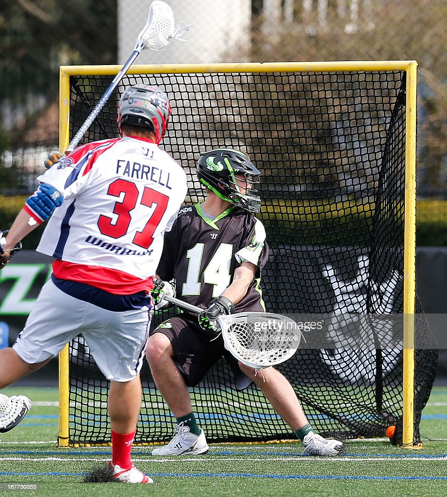 Goalie Drew Adams #14 of the New York Lizzards looks over as Brian Farrell #37 of the Boston Cannons shoots the ball into the low corner for a goal in the second half of a Major League Lacrosse game at James M. Shuart Stadium on April 28, 2013 in Hempstead, New York.