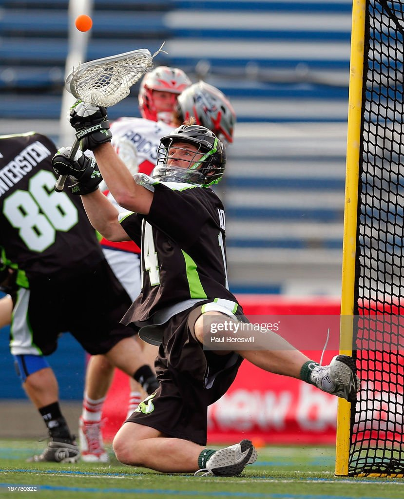 Goalie Drew Adams #14 of the New York Lizzards makes a big save in the second half of a Major League Lacrosse game against the Boston Cannons at James M. Shuart Stadium on April 28, 2013 in Hempstead, New York.