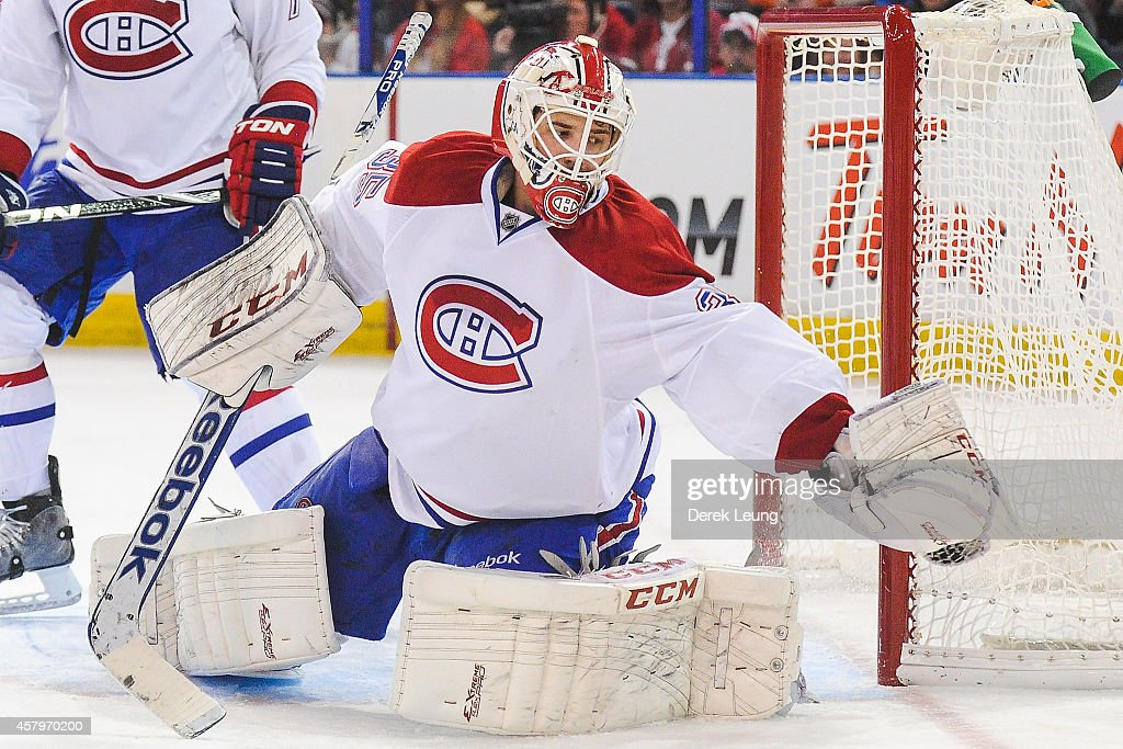 Goalie Dustin Tokarski #35 of the Montreal Canadiens makes a glove save against the Edmonton Oilers during an NHL game at Rexall Place on October 27, 2014 in Edmonton, Alberta, Canada. The Oilers defeated the Canadiens 3-0.