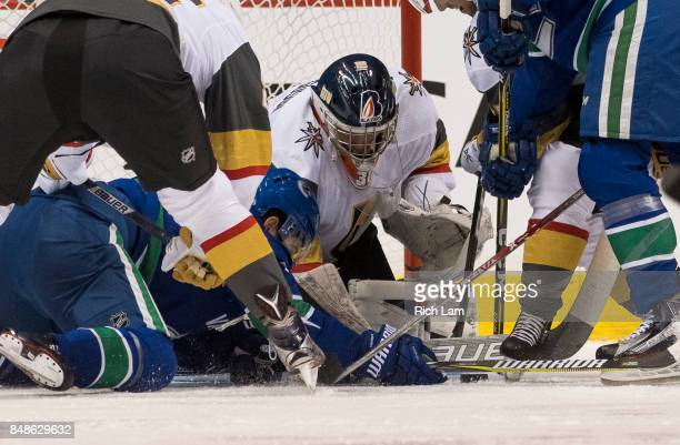 Goalie Dylan Ferguson of the Vegas Golden Knights scrambles to cover up the puck after making a save against the Vancouver Canucks in NHL preseason...
