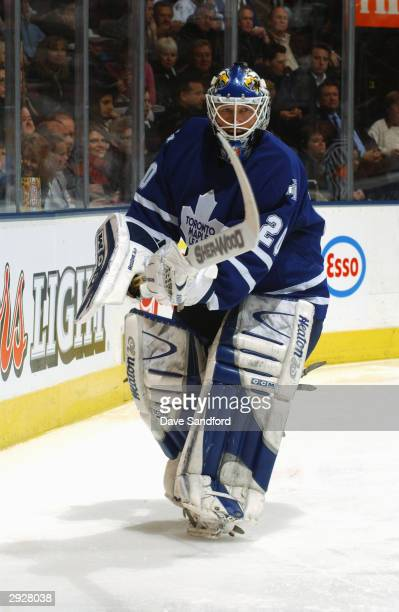 Goalie Ed Belfour of the Toronto Maple Leafs skates behind the net during the game against the Tampa Bay Lightning at Air Canada Centre on December...
