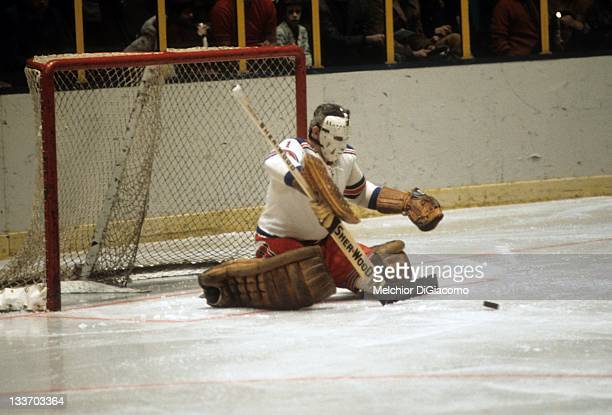 Goalie Ed Giacomin of the New York Rangers looks to make the save during an NHL game in February 1972 at the Madison Square Garden in New York New...