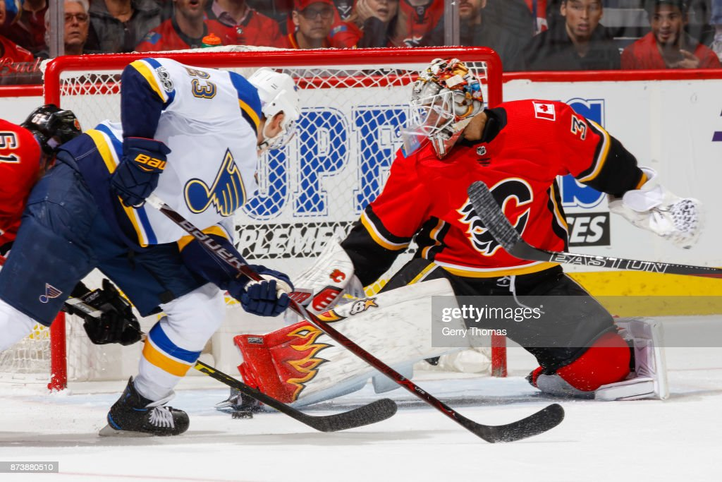 Goalie Eddie Lack #31 of the Calgary Flames tries to stop a shot in an NHL game against the St. Louis Blues at the Scotiabank Saddledome on November 13, 2017 in Calgary, Alberta, Canada.