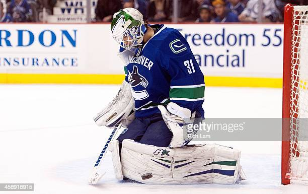 Goalie Eddie Lack of the Vancouver Canucks makes a pad save against the Winnipeg Jets during the first period in NHL action on December 22 2013 at...
