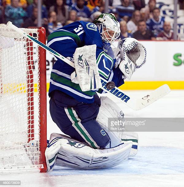 Goalie Eddie Lack of the Vancouver Canucks makes a save against the Tampa Bay Lightning during the second period in NHL action on January 01, 2014 at...