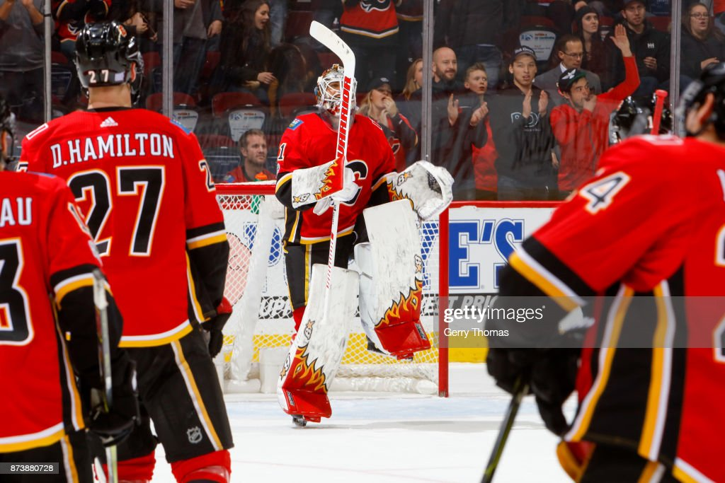 Goalie Eddie Lack #31of the Calgary Flames celebrates dancing in an NHL game against the St. Louis Blues at the Scotiabank Saddledome on November 13, 2017 in Calgary, Alberta, Canada.