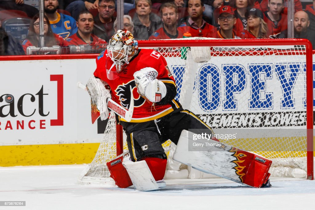 Goalie Eddie Lack #31of the Calgary Flames faces a shot in an NHL game against the St. Louis Blues at the Scotiabank Saddledome on November 13, 2017 in Calgary, Alberta, Canada.