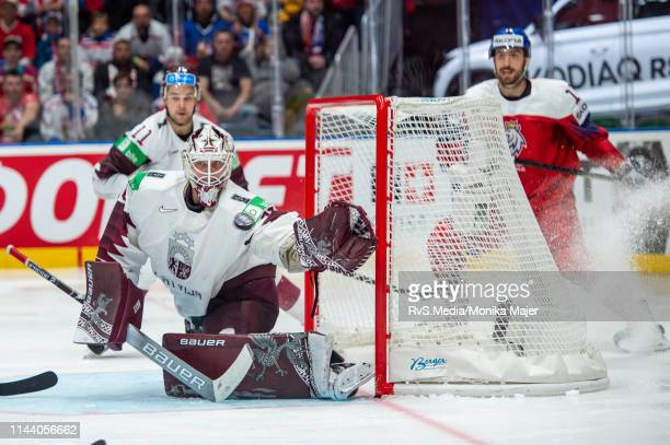 Goalie Elvis Merzlikins makes a glove save during the 2019 IIHF Ice Hockey World Championship Slovakia group game between Czech Republic and Latvia...
