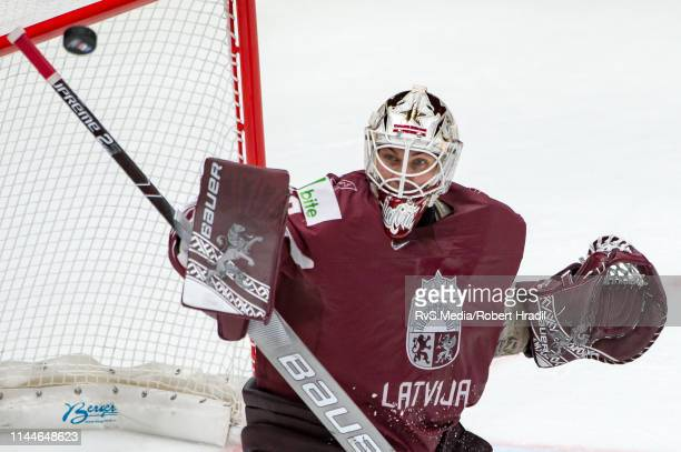 Goalie Elvis Merzlikins of Latvia makes a save during the 2019 IIHF Ice Hockey World Championship Slovakia group game between Latvia and Russia at...