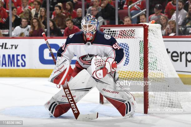Goalie Elvis Merzlikins of the Columbus Blue Jackets watches for the puck in the first period against the Chicago Blackhawks at the United Center on...