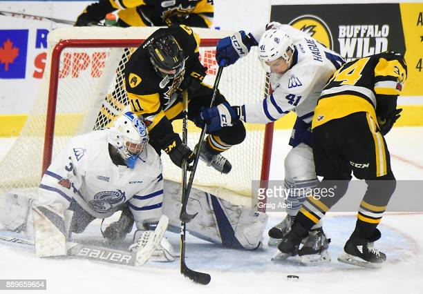 Goalie Emanuel Vella and Nicolas Hague of the Mississauga Steelheads battle in the crease with Isaac Nurse and Arthur Kaliyev of the Hamilton...