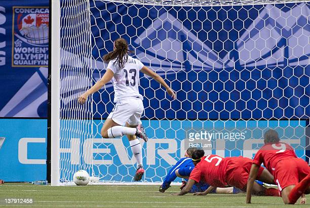 Goalie Erin McLeod of Canada along with teammates Robyn Gayle and Candace Chapman watch Alex Morgan's of the United States shot go into the net...
